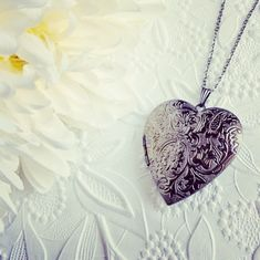 Back in Stock! Large heart lockets in gunmetal silver finish. What would you put inside? Heart Locket, Lockets, Mom Style, It Is Finished, Exterior, Pendant Necklace, Memories, Board, Womens Fashion