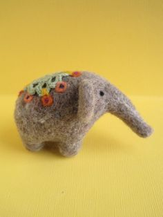 "needle felting   He looks easy enough, right? Wrong!! That's the trick of needle felting. You see these little fellas and think ""hmm...I can do that!"" and then 3 hrs later I've got bloody thumbs and fingers and a giant matted ball of roving. Sigh.   I you little elephant"
