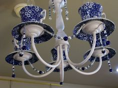 Repurposed Chandelier Lighting with Vintage Calico Teacups. $245.00, via Etsy.