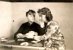 The young Leonard Dowdy is seated at a table making Valentine's Day cards with Gertrude Stenquist, who wrote The Story of Leonard Dowdy: Deaf-Blindness Acquired in Infancy (1974). They are using the Tadoma method to communicate.      Date: circa 1936. Visit the Perkins Archives Flicker page: http://www.flickr.com/photos/perkinsarchive/collections/