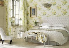 As much as I love roses I think I'd go with plain walls.  Love the curtains and the headboard, tho.
