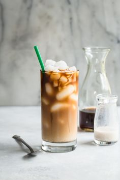 Easy to make iced coffee with vanilla almond milk and cardamom. Vegan dairy free and perfect for a hot summers day. Make a huge batch and keep in the fridge! Click through for this coffee drink recipe at Foodness Gracious. Homemade Iced Coffee, Vanilla Iced Coffee, Almond Milk Coffee, Iced Coffee Drinks, Coffee Drink Recipes, Iced Latte, Almond Milk Cappuccino Recipe, Coffee Mugs, Coffee Percolator