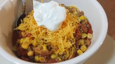 Taco Soup -  1 1/2 pounds ground beef, browned,  1 envelope taco seasoning,  2 cans corn, undrained,  2 cans ranch-style beans (pinto beans in seasoned tomato sauce),  2 cans diced tomatoes, undrained,  Tortilla chips, shredded cheese, sour cream (for serving)