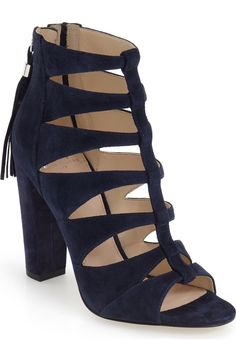 20b41429581 A chunky wrapped heel elevates this modern gladiator sandal crafted from  luxurious suede and finished with