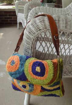 Pattern: Flapjack Purse by Perennial Blessings  Hooked by Jane Doppke  Crocheted together with hand dyed wool yarn rather than sewn.
