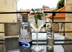 Gin Mare & Tonic 1724 with rosemary sprig, basil leave and green olives