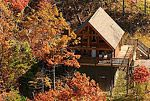 *Cherokee Sunset* is a one bedroom and one bathroom studio chalet perched on a mountain top. Private and secluded on over seven acres, Cherokee Sunset provides excellent long range views of the Smoky Mountains and the valley through a wall of glass.