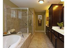 Owner's Spa Bath with Luxurious Soaking Tub and Separate Shower at Bridgemill