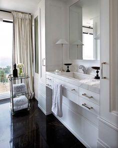 Gorgeous white bathroom with dark stone floor