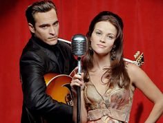 Joaquin Phoenix and Reese Witherspoon in a photoshoot for the movie Walk The Line