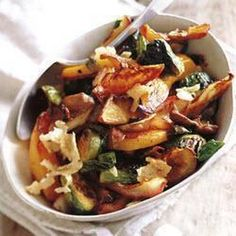 Roasted Harvest Vegetables Recipe with olive oil, garlic cloves, butternut squash, brussels sprouts, apples, sun-dried tomatoes, rosemary sprigs, salt, chestnut mushrooms, freshly grated parmesan