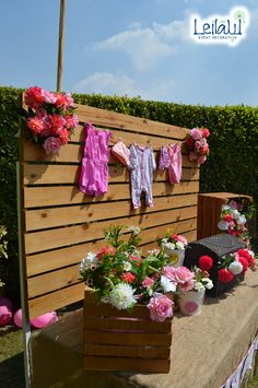 Hanging baby clothes candy table with Flowers for Baby Girl Pink Themed Baby Shower Decorations by Leila Events (01164). For orders or further info call or whatsapp +201222220889