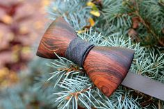 These wooden bow ties are handcrafted out of the exotic wood Cocobolo. Cocobolo is one of the most expensive woods in the world and is native to Mexico and Central America. Known for its rich color and incredible grain patterns, its high natural oil content allows it to develop a