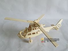 Wood 3D Puzzle Children Toy Handmade Small Assembling Puzzle Tetralogy Fighter Helicopter Model $6.20