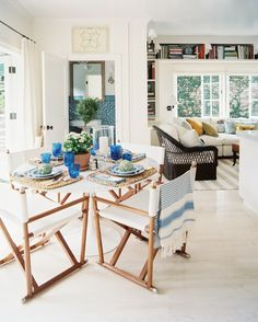 Mark D. Sikes & Michael Griffin - White director-style chairs surrounding a white tulip table