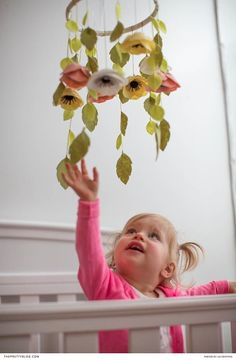 Brighten up any child's room with this DIY felt flower mobile - easy to make and fun to do with the kids! | Photography by Lia Griffith