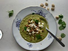 Broccoli cilantro soup with goat's cheese and pistacchios