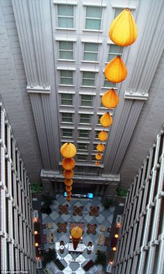 The atrium of the Renaissance Hotel in Saigon, Vietnam uses traditional features to show the grand space to effect