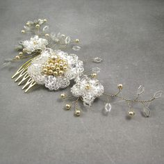 Check out this item in my Etsy shop https://www.etsy.com/listing/466358110/flower-hair-decoration-wedding-headpiece