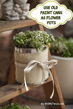 love the burlap & bow wrapped around the can - another idea for table decorations - perhaps use small cans with burlap/ribbon with a single bloom mixed in with the mason jar/pickle/spaghetti jars etc...
