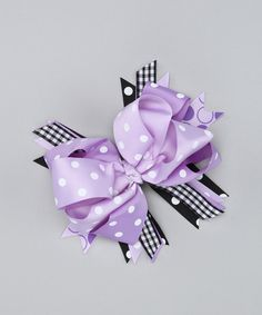 """The perfect outfit needs the perfect accessory. This fancy bow features bright colors and contrasting prints so ensembles are enhanced but never overdone.7"""" W x 1.5"""" HCotton / polyesterImported"""