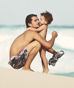 Orlando Bloom with Flynn on the beach