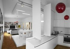 Amazing Spaces That Make One-Room Living Enviable. I like the idea of a sliding partition that slides into the wall when not in use keeping the open plan feeling but you can slide it across the bench space so you dont have to see the messy kitchen. cool.