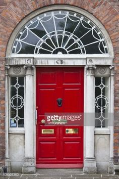 Traditional doorway with fanlight windows in Merrion Square famous for its Georgian architecture Dublin Ireland