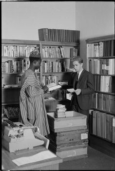 319463PD: A Nigerian librarian training at South Perth Public Library visits the Circulation Section of the Library & Information Service of W.A., 1966. https://encore.slwa.wa.gov.au/iii/encore/record/C__Rb3430635