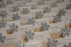 snowflake wedding escort cards with glitter