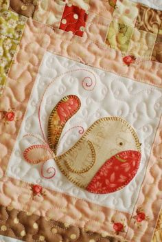 Tail Feathers - Block of the month: Sweet round bird designed by Natalie @ cinderberry stitches