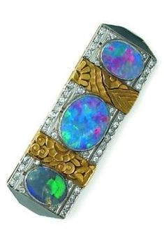 Platinum, gold, diamond and opal brooch, circa 1920. Set with three oval black opals, interspersed with carved gold flowers set with diamonds, mounted in platinum. Numbered and indistinct maker's mark 'CB'? #ArtDeco #brooch