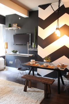 chevron in the dining room, white ceiling and beam in the living room, gray walls in the living room