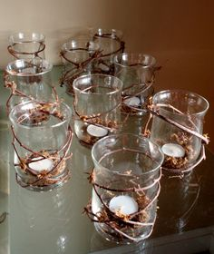 Rustic Wedding Decor Grapevine Candle Holder. Instead of vases, mason jars could be a good sub.