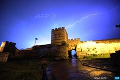 TURKEY, Istanbul : Lightning flashes are pictured during a storm above  historical Byzantium walls on May 7, 2015 in Istanbul. AFP PHOTO / OZAN  KOSE