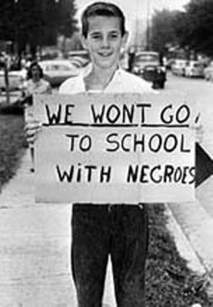 "This picture shows a young caucasian that is holding a poster saying ""We won't go to school with negroes."" Because of the Jim Crow Laws these children are learning to be racist towards African Americans. Black Power, Jim Crow, Civil Rights Movement, Before Us, African American History, History Facts, Oppression, World History, Black History"