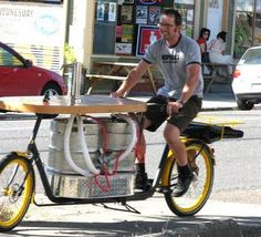 The Hopworks Bar Bike is a mobile party with 2 kegs, a rack for 3 large pizzas and a solar powered mp3 player