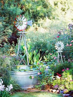 Galvanized stock tanks, which typically hold water for livestock, are perfect for an easy-to-build water feature:  http://www.bhg.com/gardening/landscaping-projects/water-gardens/dream-water-gardens/?socsrc=bhgpin031514downonthefarm&page=10
