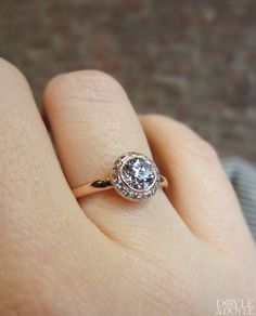 Rose gold halo engagement ring with an Old European cut diamond, surrounded by a frame of smaller diamonds. Heirloom by Doyle & Doyle.