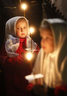 Moscow, Russia: Children hold candles during an Easter service Photograph: Mikhail Voskresensky/Reuters I find this moving...