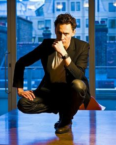 He's doing a Loki pose...on a table...
