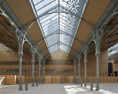 Completed in 2014 in Paris, France. Images by Fernando Javier Urquijo. The Carreau du Temple, a historic steel and glass market from 1868 located in the Marais district of Paris, was reopened by the mayor of Paris on Industrial Architecture, Interior Architecture, Unique Architecture, Steel Frame Construction, Architecture Wallpaper, Wallpaper Magazine, Steel Structure, Glass House, Metal Roof
