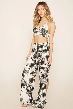 A pair of woven pants by R by Raga™ with an allover tie-dye print, high side slits, a wide-leg silhouette, and a concealed back zipper. Matching crop top available.  #f21brandedshop