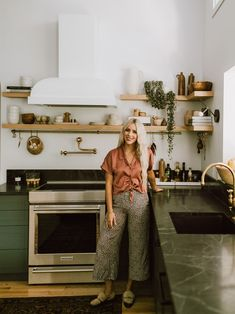 This Green Kitchen Taught Us Six Save Vs. Splurge Remodel Lessons Interior designer Jaclyn Peters shares six big splurge and save moments from a gorgeous green kitchen remodel in Winnipeg. Dark Green Wall, Dark Green Kitchen, Green Kitchen Cabinets, 70s Kitchen, Kitchen Hoods, Upper Cabinets, Kitchen Wood Shelves, Kitchens With Open Shelving, Green Kitchen Walls
