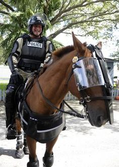 Fully geared Tampa policeofficer Tim Pasley on his horse demonstrates their deployment stance during training for the Republican National Convention in Tampa. #GOP2012