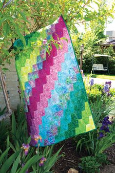 Diagonal color arrangement adds movement and interest to this colorful lap quilt.