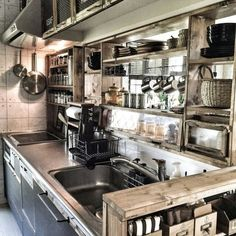 Rustic industrial. Love the rawness of the open shelving.