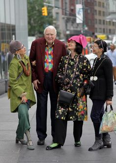 so much about this I like.  Love the hat on the lady on the left and her coat, the crazy pink hat and the same ladies green socks, and the general sense of fun these ladies are having with their style.  Do I need to live in New York to dress like this?