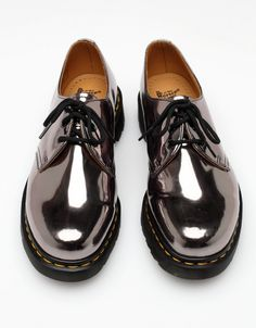 Dr. Martens - I had a pair like this once. I loved them so much, I wore them till they fell apart, and still miss them now!