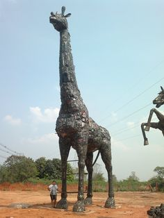 Giant scrap metal art giraffe.  Made by Scrap Metal Art of Thailand.  They  create welded metal statues ranging in size from 1 meter high to 15 meters high. Each statue is absolutely unique  one of a kind.